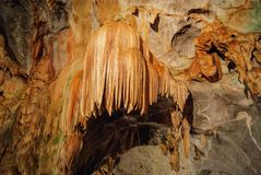 Beautiful illuminated cave formations and stalactites inside of the St. Michaels cave in Gibraltar, Upper Rock Natural Reserve, stock photography