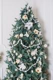 Beautiful illuminated christmas tree in a living room stock photos