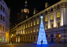 Beautiful illuminated Christmas tree on University square of Wroclaw at night time. Wroclaw. Poland stock photography