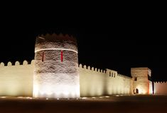 Beautiful illuminated eastern tower and walls of Riffa fort, Bahrain Stock Photo