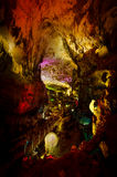 Beautiful illuminated multicolored cave and stalactites from karst Prometheus Cave. Georgia.  stock photo
