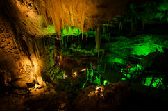 Beautiful illuminated multicolored cave and stalactites from karst Prometheus Cave. Georgia.  stock image