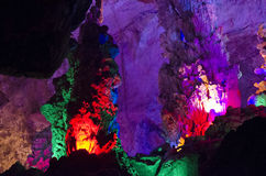 beautiful illuminated multicolored stalactites from karst Reed Flute cave. Guilin Guangxi China Stock Photo