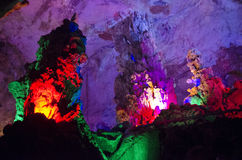 beautiful illuminated multicolored stalactites from karst Reed Flute cave. Guilin Guangxi China Royalty Free Stock Photo