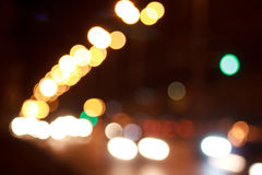 Beautiful illuminated streets with bokeh effect. Night city Stock Photos