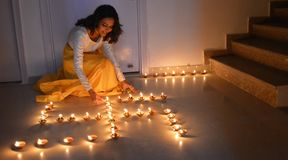 Beautiful image of a girl lighting lamps Stock Images