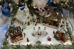 Beautiful Image Of Christmas Village, With Buildings And Ornaments Under Decorated Pine Tree Royalty Free Stock Photography