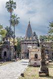 Beautiful image of sidewalk leading to the Egyptian Chapel in de Belen cemetery. With its blue and yellow dome on a wonderful sunny day with a blue sky in royalty free stock photo
