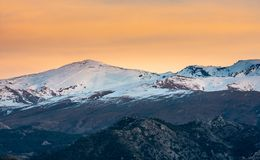 Beautiful image of Sierra Nevada sky stations and snowcapped mountains around during sunset, Granada royalty free stock photo