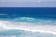 Beautiful image of turquoise blue sea and wash created by waves stock image