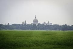 Beautiful image of Victoria Memorial snap from distance, from Moidan, Kolkata , Calcutta, West Bengal, India. A Historical Monument, large marble building stock image
