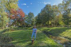 Beautiful image of a woman with casual clothes walking with her dachshund royalty free stock photography