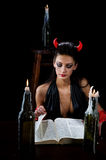 Beautiful imp read a book Royalty Free Stock Images
