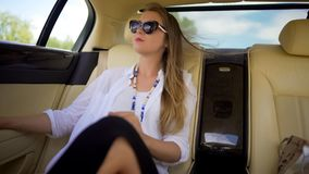 Beautiful independent woman enjoying car trip on vacation, business traveler. Stock footage Royalty Free Stock Images