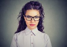 Serious young woman in glasses Royalty Free Stock Photography