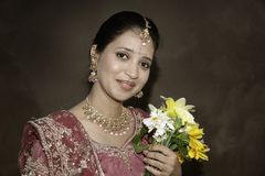 Beautiful Indian Bride. Young Indian bride with flowers in sepia color tone Royalty Free Stock Photos