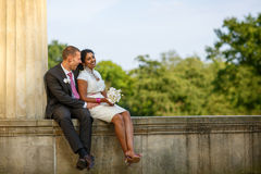 Beautiful indian bride and caucasian groom in park. BeBeautiful indian bride and caucasian groom, in summer park Royalty Free Stock Image