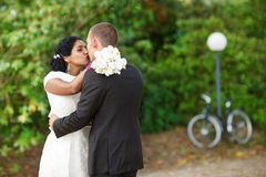 Beautiful indian bride and caucasian groom, in summer park. Beautiful indian bride and caucasian groom, in summer park Stock Photos