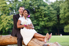 Beautiful indian bride and caucasian groom, in summer park. Beautiful indian bride and caucasian groom, in summer park Royalty Free Stock Photography