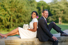 Beautiful indian bride and caucasian groom, in summer park. Beautiful indian bride and caucasian groom, in summer park Stock Photography