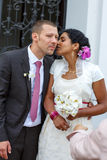 Beautiful indian bride and caucasian groom, after wedding ceremo Stock Photos