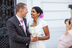 Beautiful indian bride and caucasian groom, after wedding ceremo Stock Photography