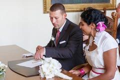 Beautiful indian bride and caucasian groom during wedding ceremo. Beautiful indian bride and caucasian groom,  during wedding ceremony Royalty Free Stock Photos