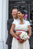 Beautiful indian bride and caucasian groom, after wedding ceremo. Ny Royalty Free Stock Photography