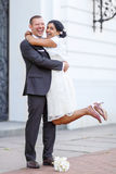Beautiful indian bride and caucasian groom after wedding ceremon. Beautiful indian bride and caucasian groom,  after wedding ceremony. Happy couple in love Stock Photos