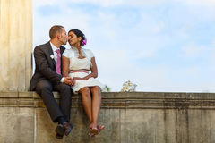 Beautiful indian bride and caucasian groom after wedding ceremon Stock Photography