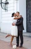 Beautiful indian bride and caucasian groom after wedding ceremony. BeBeautiful indian bride and caucasian groom, after wedding ceremony Royalty Free Stock Photo