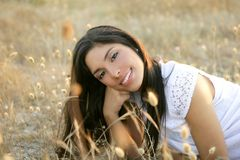 Beautiful indian brunette in a golden field Royalty Free Stock Photo