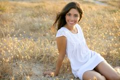 Beautiful indian brunette in a golden field Royalty Free Stock Photos