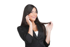 Beautiful Indian business woman flirting by phone. Royalty Free Stock Images