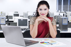 Beautiful indian businesswoman sitting in the office Stock Images