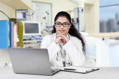 Beautiful indian doctor in the workplace Stock Image