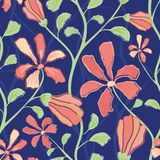 Beautiful indian floral design with coral flowers and green foliage. Seamless vector pattern on midnight blue background. Great