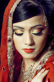 Beautiful indian girl with bridal makeup. Beauty portrait of a young indian woman in traditional clothing with bridal makeup and jewelry, closeup shot Royalty Free Stock Photos