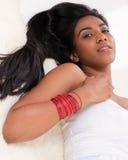 Beautiful Indian girl on furs Royalty Free Stock Photos