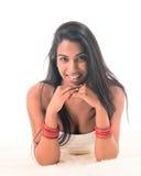 Beautiful Indian girl on furs Stock Photography