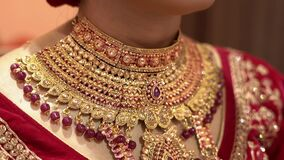 Beautiful Indian girl with gold jewelry for woman ,necklace ,earrings and bracelet. Beauty and accessories