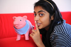 Beautiful Indian girl holding piggybank Royalty Free Stock Image
