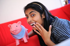 Beautiful Indian girl holding piggybank Stock Images