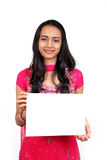 Beautiful indian girl holding a white banner. Stock Images