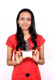 Beautiful Indian girl holding a white banner. Royalty Free Stock Photography