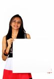 Beautiful Indian girl holding a white board. Royalty Free Stock Image