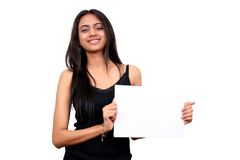Beautiful indian girl holding a white sign. Royalty Free Stock Photos