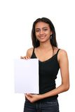 Beautiful indian girl holding a white sign. Stock Images