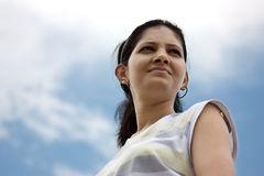 A beautiful Indian girl looking at sky Royalty Free Stock Photos