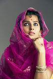 Beautiful Indian girl looking up Stock Image